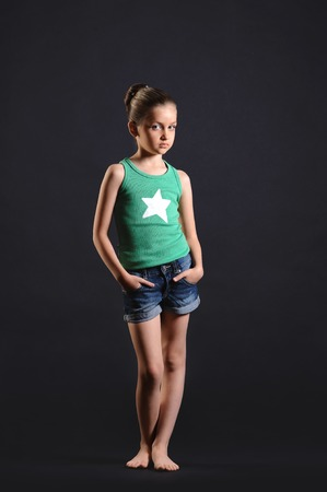 girl in full growth: portrait of a beautiful girl barefoot in full growth  over dark background