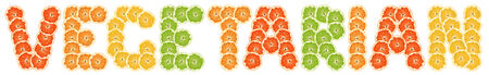 vegetarian -  text of slices of citrus fruit on white background. photo