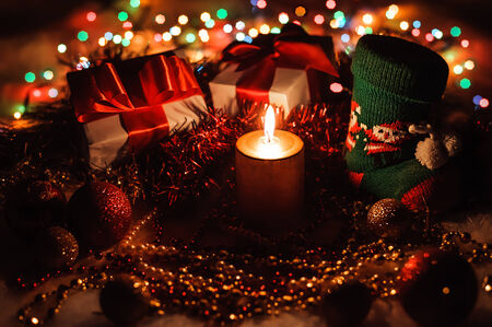 Holiday composition with candle and decorations. New Year Celebration. Christmastime photo