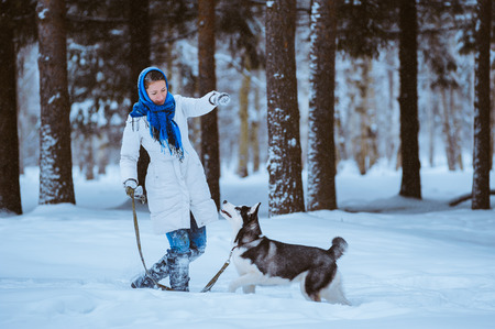 young woman in the winter park with a dog Husky photo