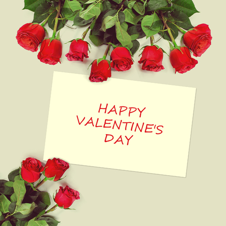acknowledgment: Roses bouquet and greeting card with sample text. Happy Valentines Day. Stock Photo