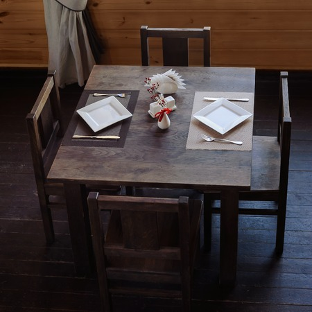 wooden furniture: interior of resturant with wooden furniture, wooden served table