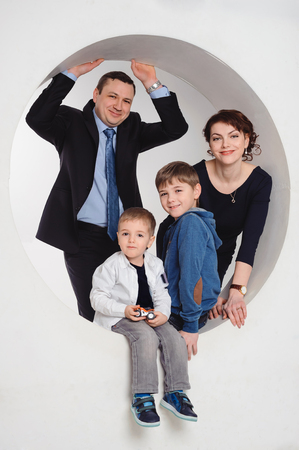 studio portrait of smiling family with two children photo