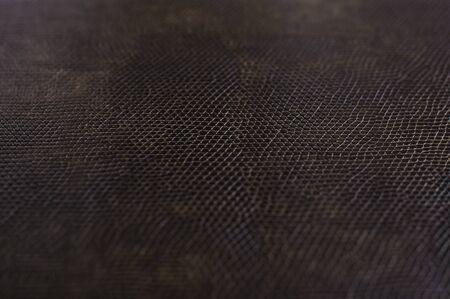 imitation leather: brown texture leather, imitation leather iguana, selective focus