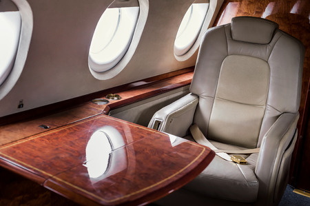 Table and seat inside of small business jet