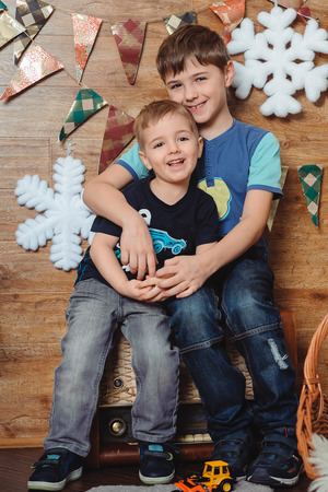 christmastime: portrait of two smiling children  looking at camera, christmastime