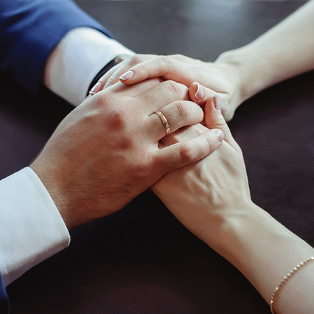 gently: couple in love gently hold hands. top view Stock Photo