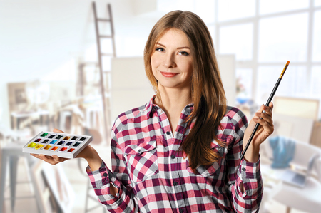 talented: talented smiling woman painter with brushes and palette,