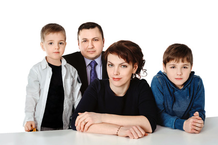 Portrait of loving family with two children isolated over a white background