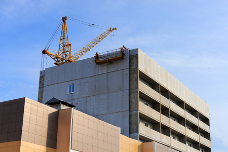 multistory: The process of construction of multistory building. Construction site with crane