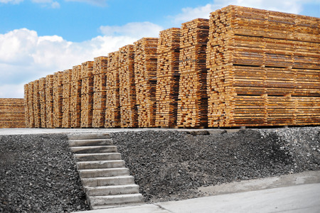 stacked up: Stacked up lumber in warehouse. Outdoors. Woodworking industry Stock Photo