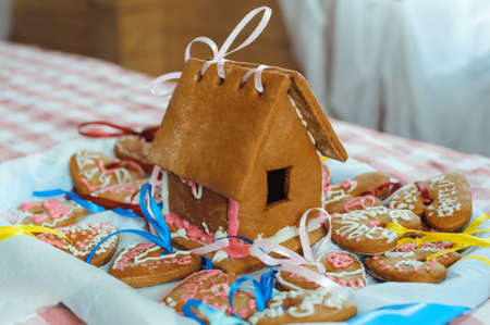 Homemade gingerbread house and decorated gingerbread hearts for wedding and Valentines day.