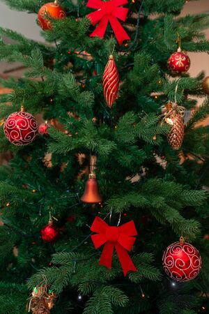 Christmas tree decorated with red balls and bows. Christmas and New Year decoration