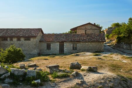 Old abandoned building. Stone house in the mountains. Sunny summer day.