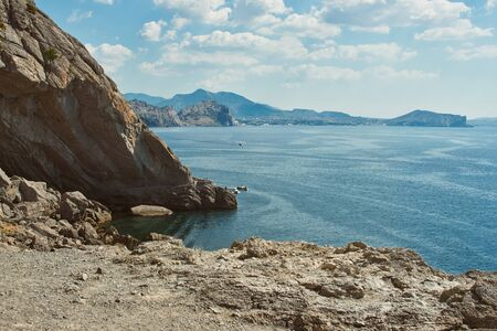 Scenic view of mountains and sea. Sea coast with rocky cliffs. Peaked rocks on the seashore. Black Sea