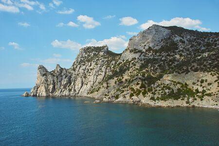 Scenic view of rocky headland and sea. Sea coast with rocky cliffs. Peaked rocks on the seashore. Black Sea