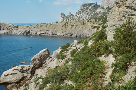 Scenic view of huge cliffs and sea. Sea bay surrounded by rocky mountains. Black Sea