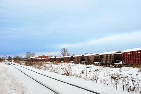 Railroad tracks in winter time. Railway infrastructure. Steel railway for trains in snow