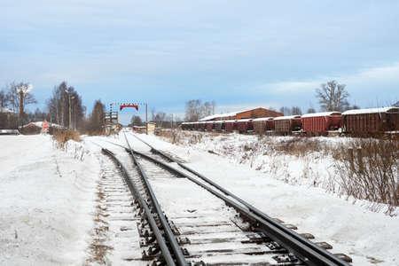 Railroad tracks in winter time. Railway infrastructure. Steel railway for trains in snow. Railway tracks with crossing 版權商用圖片