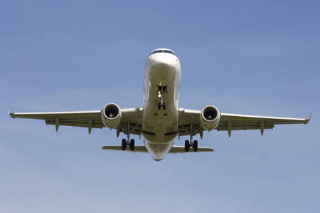 Photo of mid-range airliner taken during approach to the runway. Stock Photo