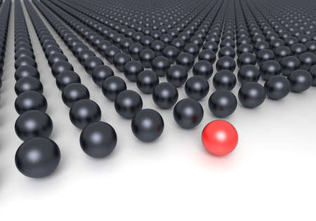 Leadership concept. Red sphere and multiple black spheres photo
