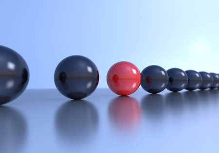 Unique concept. Red sphere in a row with black spheres. Depth of field is set on red sphere. photo