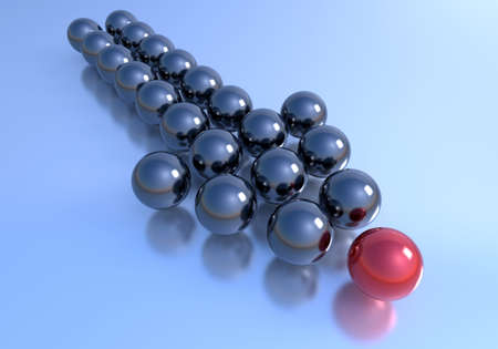 Leadership concept. An arrow formed with multiple dark spheres and one unique red on top. photo