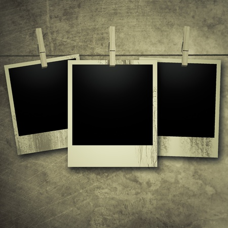 polaroid frame: Vintage polaroid photos on line with pegs