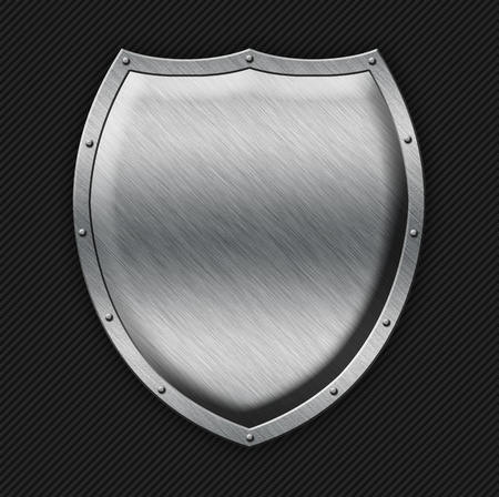 Aged metal shield on carbon background