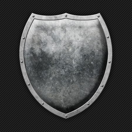 Aged metal shield on carbon background Stock Photo - 18144115