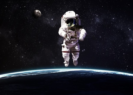 astronaut space: Astronaut in outer space against the backdrop of the planet earth.