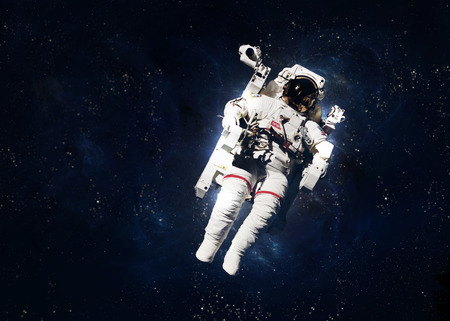 future space: Astronaut in outer space against the backdrop of the planet earth.