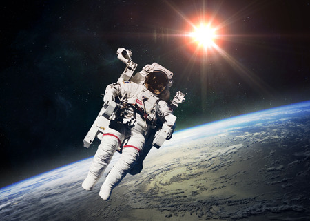 outer space: Astronaut in outer space against the backdrop of the planet earth.