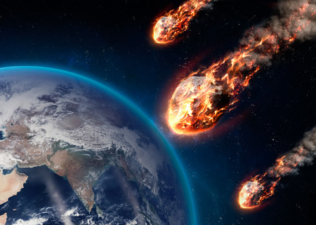 A Meteor glowing as it enters the Earths atmosphere.  Stock Photo