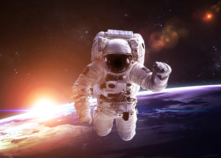 spaceship: Astronaut in outer space against the backdrop of the planet.