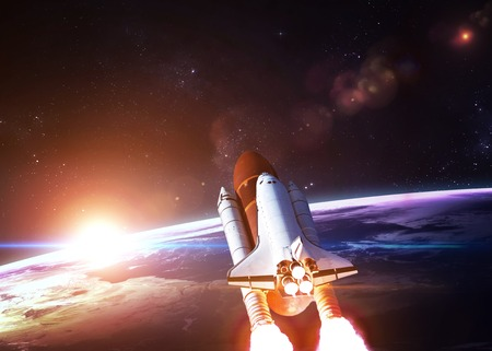 astronaut in space: Space shuttle taking off on a mission.