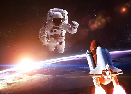 astronaut space: Astronaut in outer space against the backdrop of the planet.