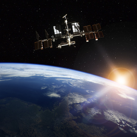 international: Space Station Orbiting Earth.  Stock Photo