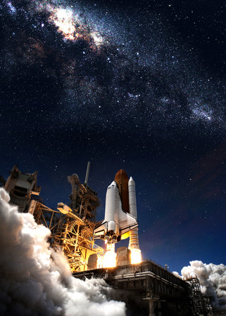 space background: Space shuttle taking off on a mission.