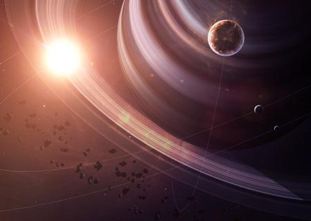 imagen: El Saturno con las lunas tiro del espacio que muestra todo lo que la belleza. Extremadamente detallado de imagen, incluidos los elementos aportados por la NASA. Otras orientaciones y planetas disponibles.