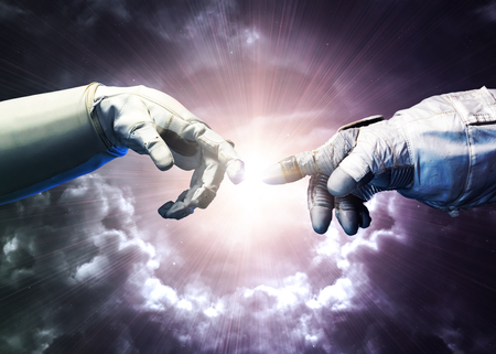 Michelangelo Gods touch. Close up of human hands touching with fingers in space.   Stock Photo