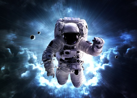 An astronaut floats above billions of stars. Stars provide the background.