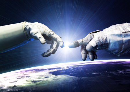 Michelangelo God\'s touch. Close up of human hands touching with fingers in space.