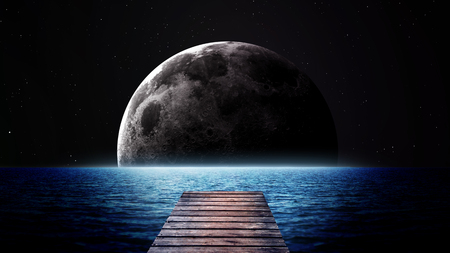 alone in the dark: Rising moon over sea. Elements of this image furnished by NASA