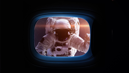 soyuz: Beautiful cosmos in space ship window porthole. Elements of this image furnished by NASA. Stock Photo