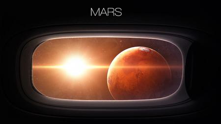 superficie: Marte - Belleza del planeta del sistema solar en la ventana de ojo de buey de la nave espacial.