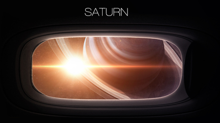 nasa: Saturn - Beauty of solar system planet in spaceship window porthole. Elements of this image furnished by NASA