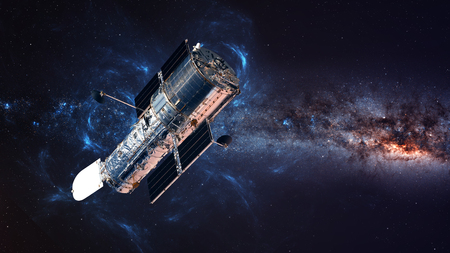 De Hubble Space Telescope in baan boven de Aarde.