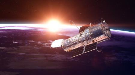 take a history: The Hubble Space Telescope in orbit above the Earth.