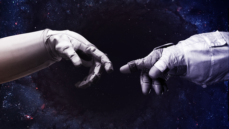 light god: Michelangelo Gods touch. Close up of human hands touching with fingers in space. Stock Photo